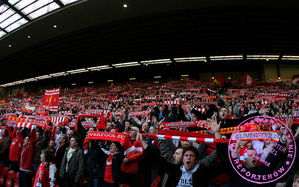 """Liverpool fans at the Kop End sing their traditional """"You'll Never Walk Alone"""" anthem"""