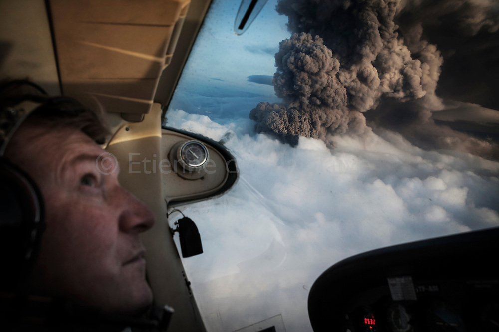 Seen from a Cessna aircraft, ash plume from Iceland's Eyjafjallajokull crater during it's eruption, spewing tephra and ashes that drift toward continental Europe. On this day the ash cloud rose to an average of 6 km (20,000 ft) peaking at 8 km (26,000 ft) said Icelandic Meteorological Office and Institute of Earth Sciences, University of Iceland. 14 May 2010.