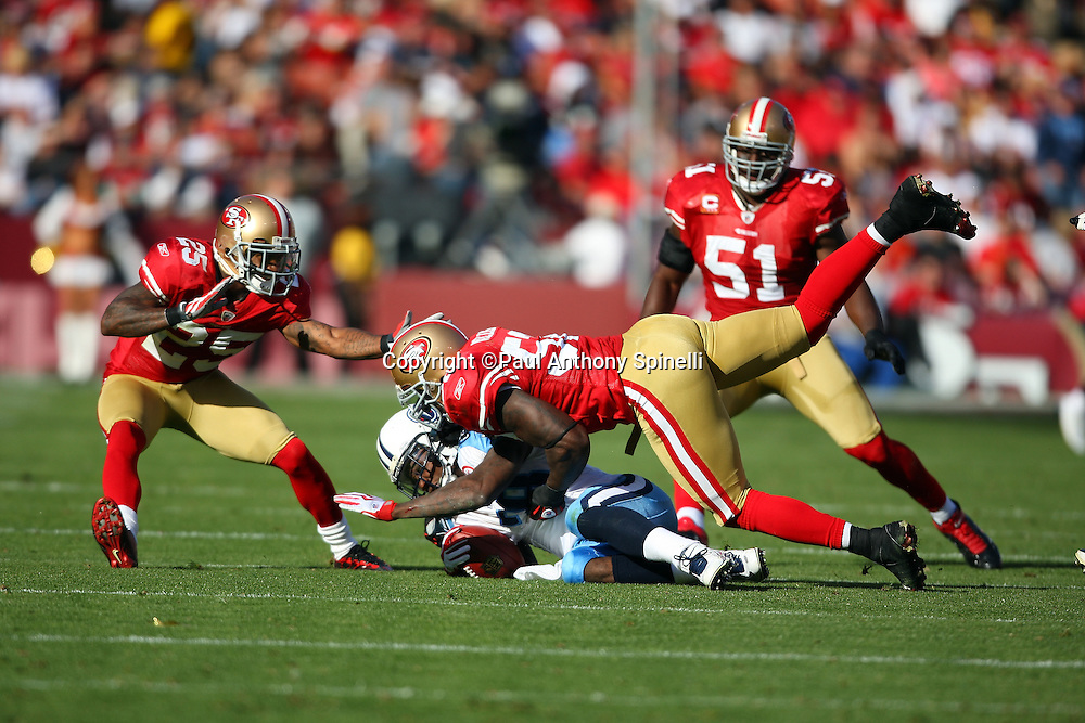 Tennessee Titans running back Chris Johnson (28) gets tackled by diving San Francisco 49ers linebacker Patrick Willis (52) during the NFL football game against the San Francisco 49ers, November 8, 2009 in San Francisco, California. The Titans won the game 34-27. (©Paul Anthony Spinelli)