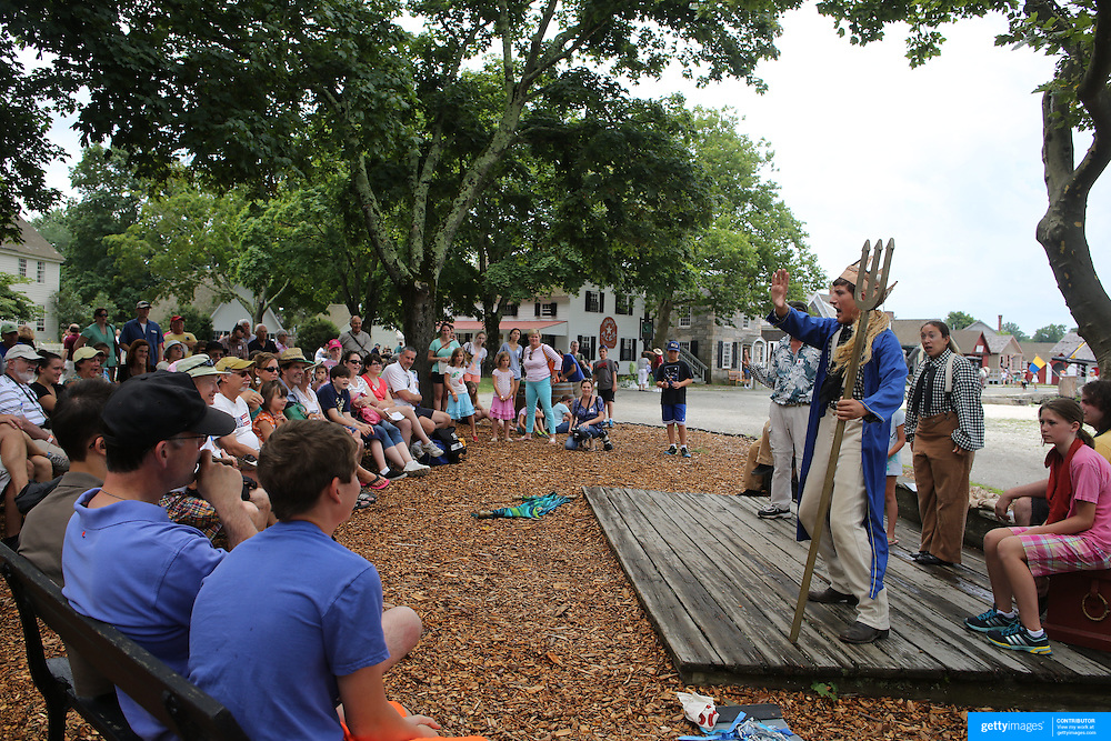 Actors perform to visitors on the historic waterfront at Mystic seaport. Mystic, Connecticut. 21st July 2013. Photo Tim Clayton