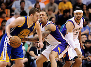 Apr 5, 2013; Phoenix, AZ, USA; Golden State Warriors forward David Lee (10) is guarded by the Phoenix Suns forward Michael Beasley (0) as forward Jared Dudley (3) watches on in the second half at US Airways Center. The Warriors defeated the Suns 111-107. Mandatory Credit: Jennifer Stewart-USA TODAY Sports