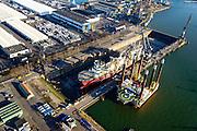 Nederland, Zuid-Holland, Rotterdam, 18-02-2015. Botlek, de werf van Keppel Verolme. De Deep Energy, offshore pijpenlegger in het droogdok voor onderhoud. Naast het dok het onderhoudsplaform, Seafox 4.<br /> Pipelay vessel in drydock for maintenance.<br /> luchtfoto (toeslag op standard tarieven);<br /> aerial photo (additional fee required);<br /> copyright foto/photo Siebe Swart