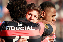 Luke Burgess celebrates with team mate Yohan Huget after he scores the second try for Toulouse. Stade Toulousain v ASM Clermont Auvergne, Top 14, Stade Municipal, Toulouse, France, 1st December 2012.