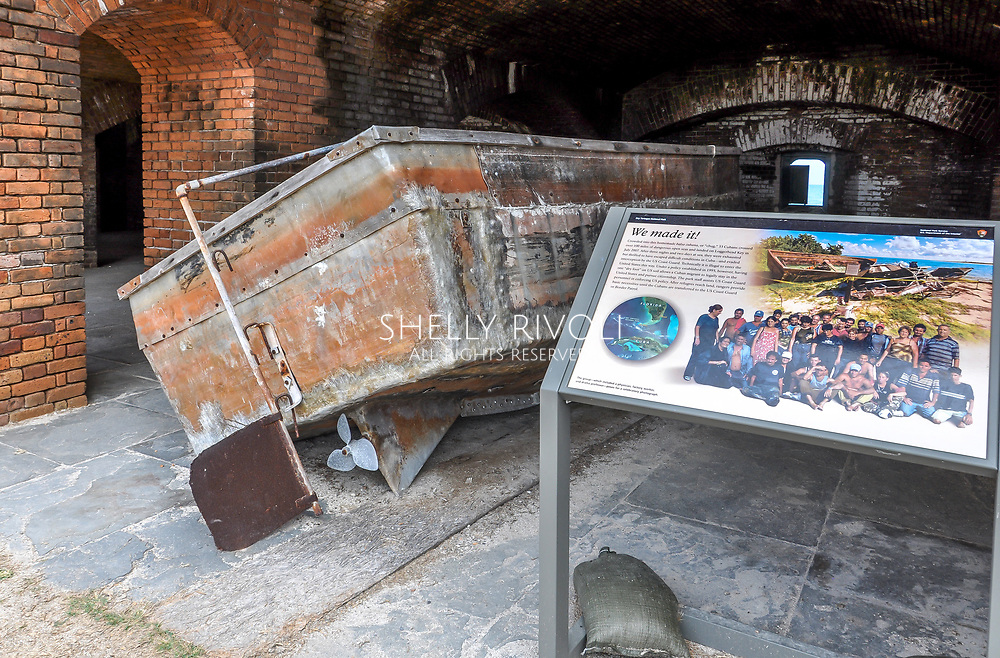 """The boat or """"chug"""" thirty-three Cubans used to cross more than 100 miles of open sea to land at Loggerhead Key in July 2007. They were able to immigrate under the U.S. """"dry foot"""" immigration policy. On display at Fort Jefferson, Dry Tortugas National Park."""