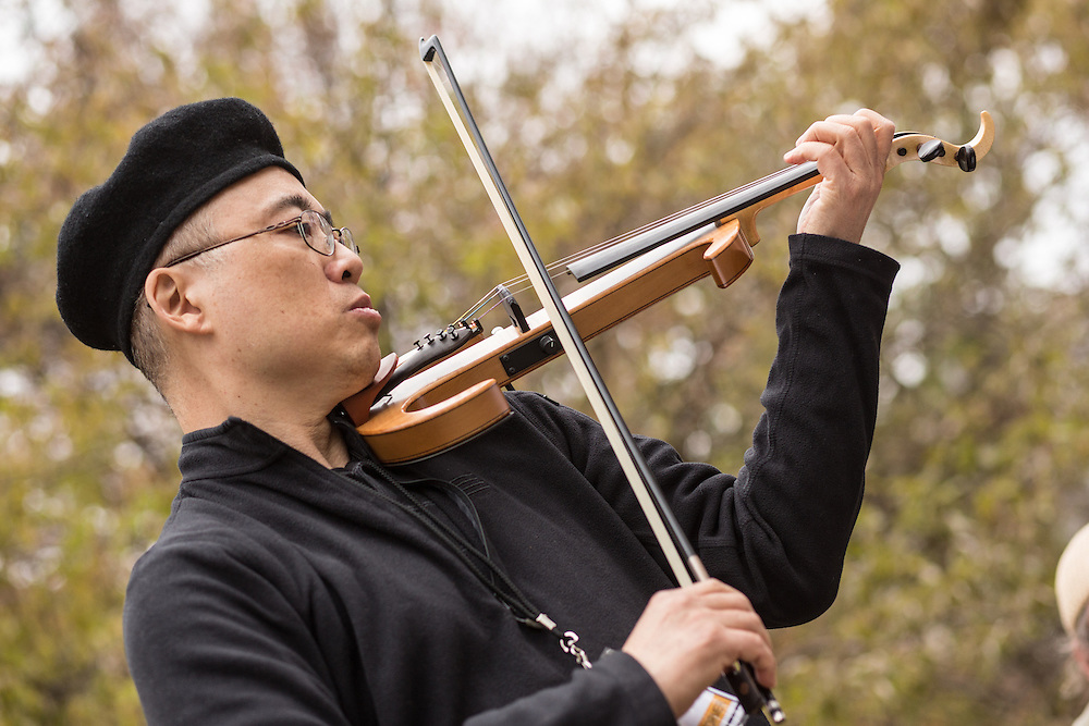 Jason Kao Hwang playing jazz at Jazz and Colors in Central Park. Hwang is a composer and performer.