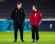 Head Coach Johann van Graan of Munster with a member of the Ospreys Coaching team<br /> <br /> Photographer Simon King/Replay Images<br /> <br /> European Rugby Champions Cup Round 1 - Ospreys v Munster - Saturday 16th November 2019 - Liberty Stadium - Swansea<br /> <br /> World Copyright © Replay Images . All rights reserved. info@replayimages.co.uk - http://replayimages.co.uk