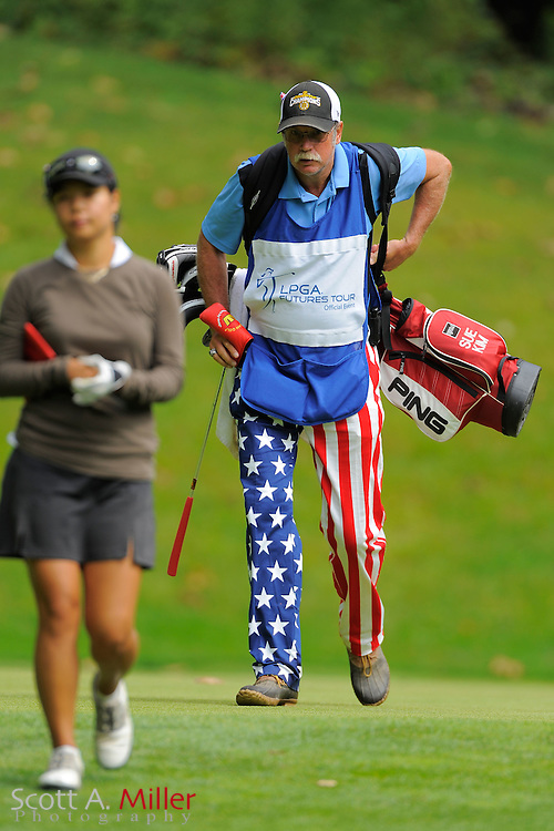 Sue Kim and her caddie during the final round of the LPGA Future Tour's Price Cooper Tour Championship at Capital Hills at Albany on Sept. 11, 2011 in Albany, N.Y...©2011 Scott A. Miller