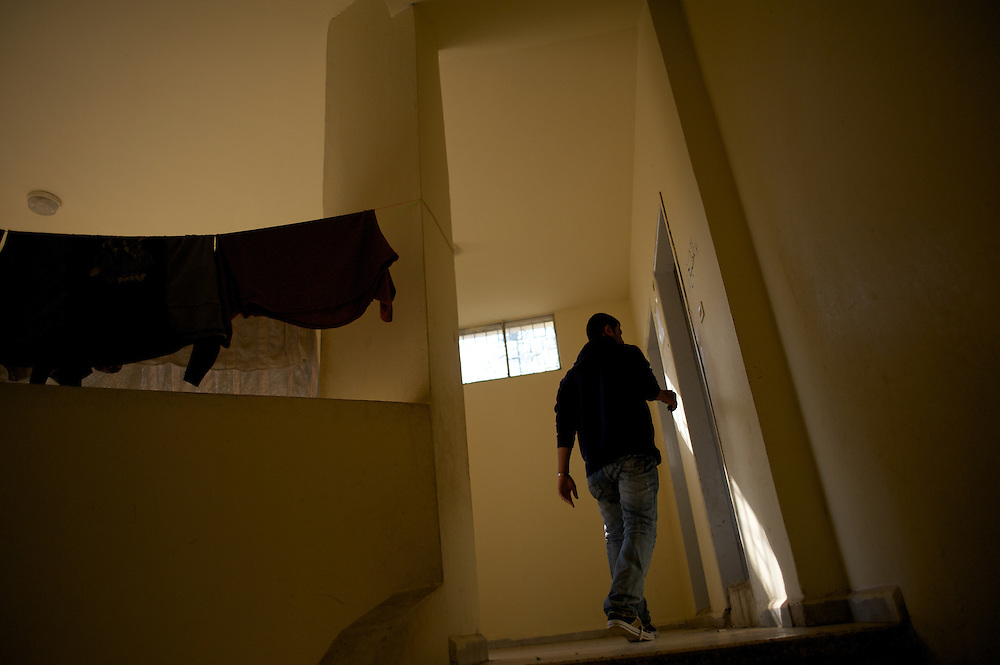 Mostafa Haloum, a syrian refugee, walks by at a refugee center in Wadi Khaled, lebanon.