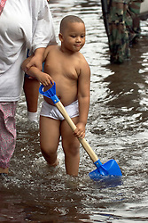 01 Sept, 2005. New Orleans, Louisiana.<br /> Mass evacuation begins. A barely clothed child in the floods. Exhausted former residents of the Superdome 'shelter of last resort' wade through flood water to get to the first busses evacuating people from New Orleans to destinations unknown.<br /> Photo©; Charlie Varley/varleypix.com