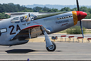 "The Commemorative Air Force's Redtail tribute P-51C Mustang, ""By Request"" at the Oregon International Airshow."