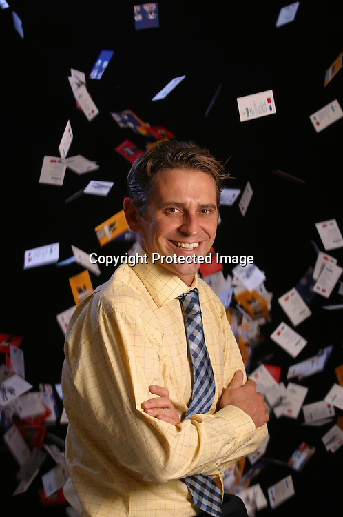 Business Sections...12 November 2003..Brady Corporation announces acquisition of B.I.G. the UK?s largest manufacturer of business cards and badges. The deal is intended to allow B.I.G. to expand and pursue their goal of becoming number one global provider of business cards and badges.......Photograph shows Graham Budinger, Commercial Director with some of B.I.G?s business card product.....Since 1996 B.I.G. has sold more than 50 million business cards and over 25 million ID badges.....For more information please contact Jim Hawker / Spreckley Partners Tel - 020 73889988 mobile- 07730 426 804....Photograph by Simon Brooke-Webb / sbw-photo. Tel ? 0208 8913199..
