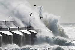 © Licensed to London News Pictures. 23/02/2017. Brighton, UK. Powerful waves hit the Brighton Marina wall as storm Doris is hitting Brighton and Hove with powerful gusts of wind up to 50 mph. Photo credit: Hugo Michiels/LNP