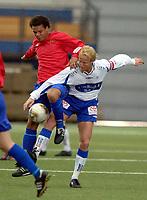 Vallhall 21.04.2003. Fotball herrer, 1. divisjon. Skeid Fotball mot FK Haugesund (3-1). Daniel Omoya Braaten (t.v) og Asle Andersen.<br /> Foto: Geir Egil Skog, Digitalsport