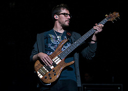 DMB bassist Stefan Lessard.  The Dave Matthews Band performed at the John Paul Jones Arena on the Grounds of the University of Virginia in Charlottesville, VA on April 17, 2009