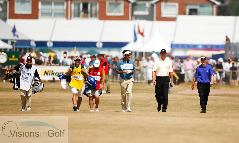 Edoardo Molinari walking up the 3rd fairway with Ernie Els and Luke Donald during the second round on 21st July 2006<br /> The Open Championship 2006, Royal Liverpool GC, Hoylake, England,UK.<br /> Picture Credit: Mark Newcombe / visionsingolf.com