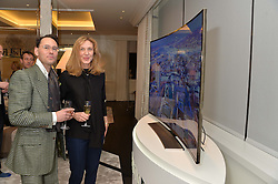 First look of the new Samsung Curved UHD TV at the Candy & Candy penthouse at No. 1 Arlington Street, London - an exclusive Samsung BlueHouse event held on 27th February 2014.<br /> Picture shows:-ANDA ROWLAND and GUY HILLS.