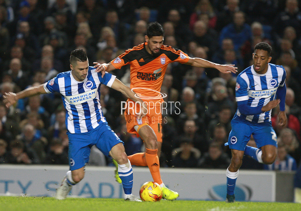 Brighton central midfielder Beram Kayal & Ipswich Town midfielder Kevin Bru battle for possession during the Sky Bet Championship match between Brighton and Hove Albion and Ipswich Town at the American Express Community Stadium, Brighton and Hove, England on 29 December 2015. Photo by Bennett Dean.
