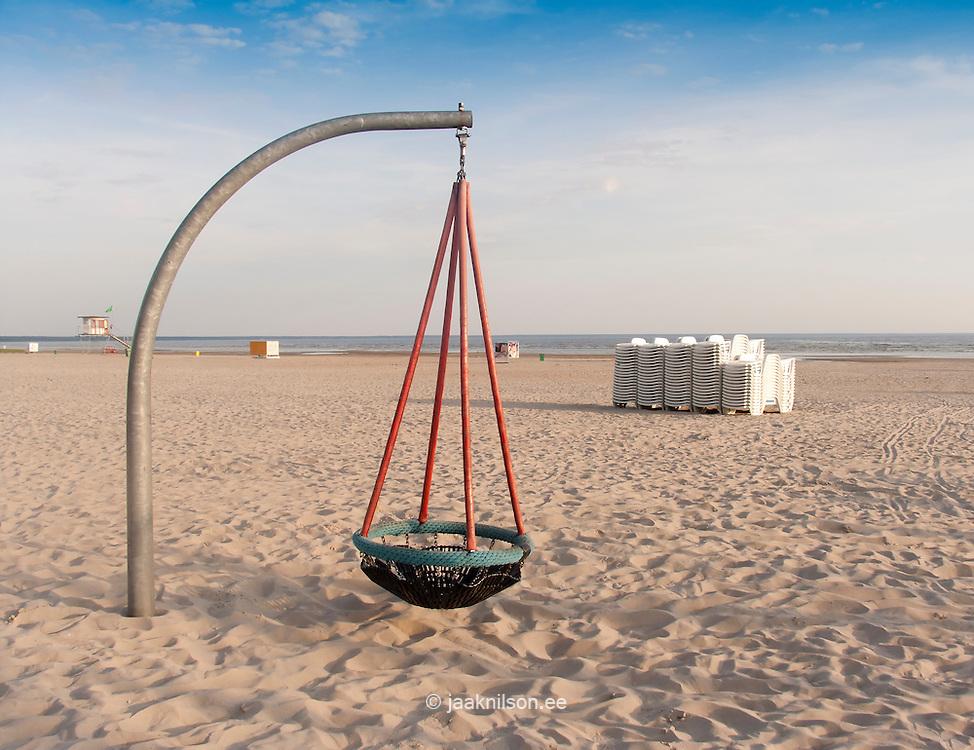 basket swing on empty beach