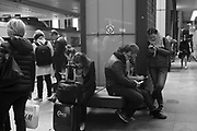Passengers wait for a train in the train station Antwerp, Belgium