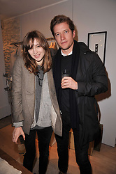 VALENTINE FILLOL CORDIER and ROBIN SCOTT-LAWSON at the launch party for Club Monaco at Browns, 32 South Molton Street, London on 16th February 2011.
