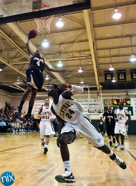 Concord's Jacquise Moore goes up for a dunk against Central Tuesday night at Central Cabarrus High School in Concord. The Spiders won the South Piedmont Conference matchup 82-75.  (Photo by James Nix)