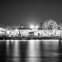 Newport Beach Balboa Fun Zone at night black and white photo. The Balboa Fune Zone is a popular attraction in Orange County Southern California. Photo is high resolution. Copyright ⓒ 2017 Paul Velgos with All Rights Reserved.