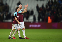 West Ham United's Mark Noble and James Collins applaud the fans at full time