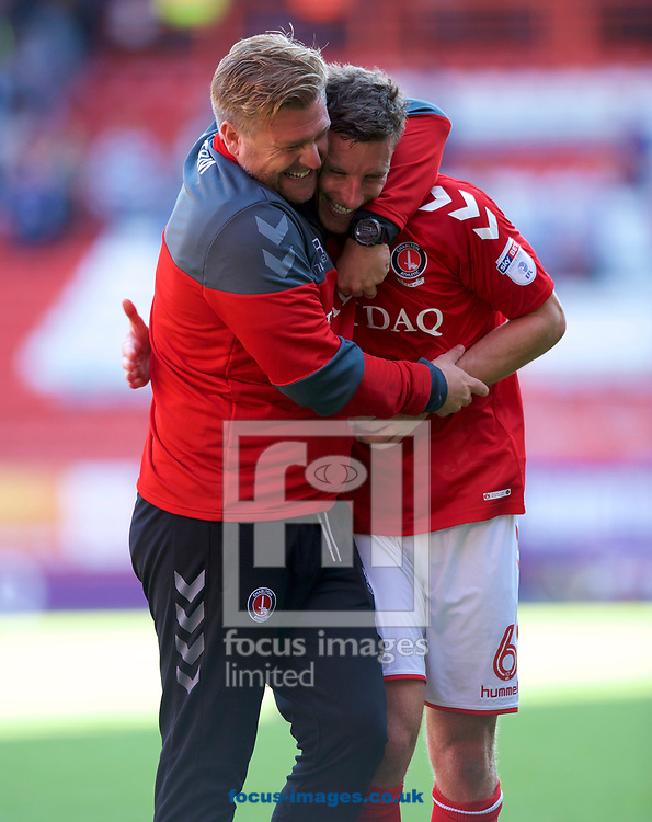 Manager Karl Robinson of Charlton Athletic celebrates their 1-0 win with Jason Pearce of Charlton Athletic after the Sky Bet League 1 match at The Valley, London<br /> Picture by Alan Stanford/Focus Images Ltd +44 7915 056117<br /> 05/08/2017