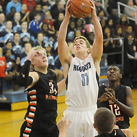 Hoggard's Jack Bagley gets a rebound from New Hanover's Brian Howell, left, Ramello Williams, back-right, and Blake Smith Friday December 12, 2014 at Hoggard High School in Wilmington, N.C. (Jason A. Frizzelle)