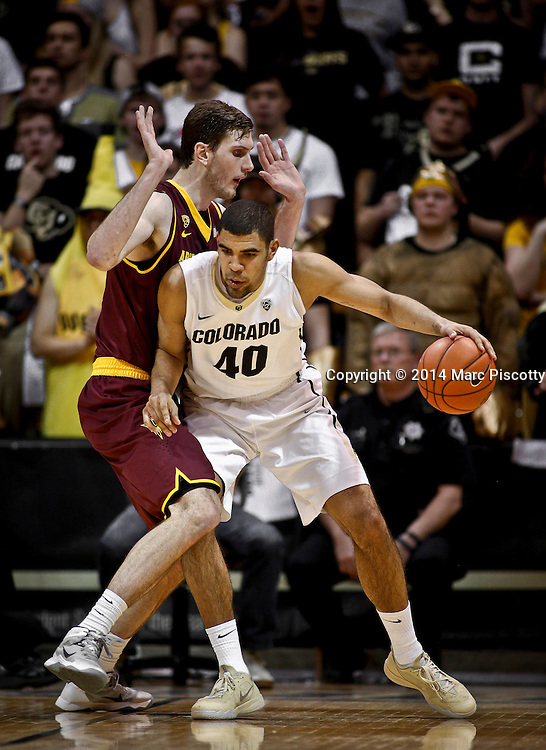 SHOT 2/19/14 10:36:58 PM - Colorado's Josh Scott #40 tries to muscle his way past Arizona State's Jordan Bachynski #13 during their regular season Pac-12 basketball game at the Coors Events Center in Boulder, Co. Colorado won the game 61-52.<br /> (Photo by Marc Piscotty / &copy; 2014)