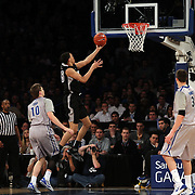 Tyler Harris, Providence, scores two points during the Creighton Bluejays Vs Providence Friars basketball game during the Big East Conference Tournament Final at Madison Square Garden, New York, USA. 15th March 2014. Photo Tim Clayton