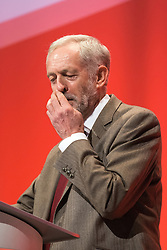 © Licensed to London News Pictures . 29/09/2015 . Brighton , UK . JEREMY CORBYN scratches his nose as he delivers his speech to the 2015 Labour Party Conference . Photo credit : Joel Goodman/LNP