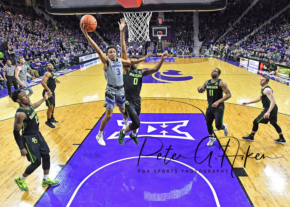MANHATTAN, KS - MARCH 02:  Kamau Stokes #3 of the Kansas State Wildcats drives in for a lay up against Flo Thamba #0 of the Baylor Bears during the second half on March 2, 2019 at Bramlage Coliseum in Manhattan, Kansas.  (Photo by Peter G. Aiken/Getty Images) *** Local Caption ***Kamau Stokes; Flo Thamba