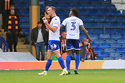 Bury defender Tom Aldred (15) and Bury defender Greg Leigh (3) celebrate during the EFL Sky Bet League 1 match between Bury and Bradford City at the Energy Check Stadium at Gigg Lane, Bury, England on 14 October 2017. Photo by Richard Holmes.