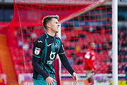 Swansea City midfielder Tom Carroll (14) reacts during the EFL Sky Bet Championship match between Barnsley and Swansea City at Oakwell, Barnsley, England on 19 October 2019.
