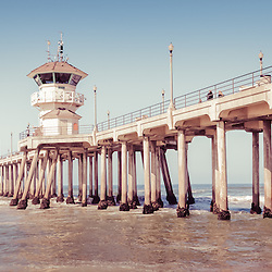 Huntington Beach Pier retro panorama picture. Panoramic photo ratio is 1:3 and has a vintage nostalgic tone. Huntington Beach Pier is a registered historic place located along the Pacific Ocean in Orange County California.