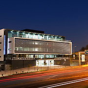 Eastgtae 20 office building at twilight with car light trails, Sandton, Johannesburg. Paragon architects.