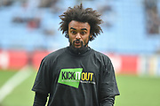 """Coventry City defender Junior Brown (12) wears a """"kick it out"""" T Shirt during the EFL Sky Bet League 1 match between Coventry City and Bristol Rovers at the Ricoh Arena, Coventry, England on 7 April 2019."""