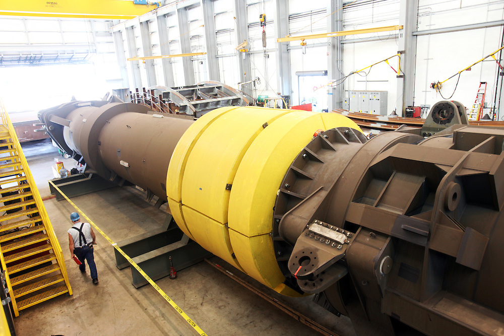 In the first commercially licensed project for generating electricity from ocean wave action, a 103-foot-long, 220-ton buoy soon to be deployed off the coast of Oregon will provide 150 kilowatts of power. The buoy, nearly completed, undergoes tests at an Oregon Iron Works facility in Vancouver, Wash.