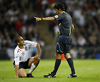Photo: Richard Lane/Sportsbeat Images.<br />England v Germany. International Friendly. 22/08/2007. <br />England's Joe Cole is booked by referee, Massimo Busacca for a foul on Germany's Piotr Trochowski.
