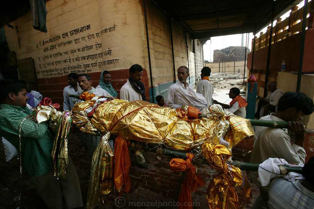 Bodies arrive day and night from far and near to be cremated at Jalasi Ghat, the cremation grounds at Manikarnika Ghat on the Ganges River in Varanasi, India. One hundred or more times a day male family members carry a loved one's body through the narrow streets on a bamboo litter to the Ganges River shore, a place of pilgrimage for Hindus during life, and at death. Not every Hindu can be cremated here, because of transportation costs and logistical considerations.