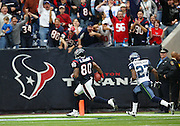 Houston Texans wide receiver Andre Johnson (80) catches a 64 yard first quarter touchdown pass good for a 7-0 lead during the NFL football game against the Seattle Seahawks on December 13, 2009 in Houston, Texas. The Texans won the game 34-7. ©Paul Anthony Spinelli
