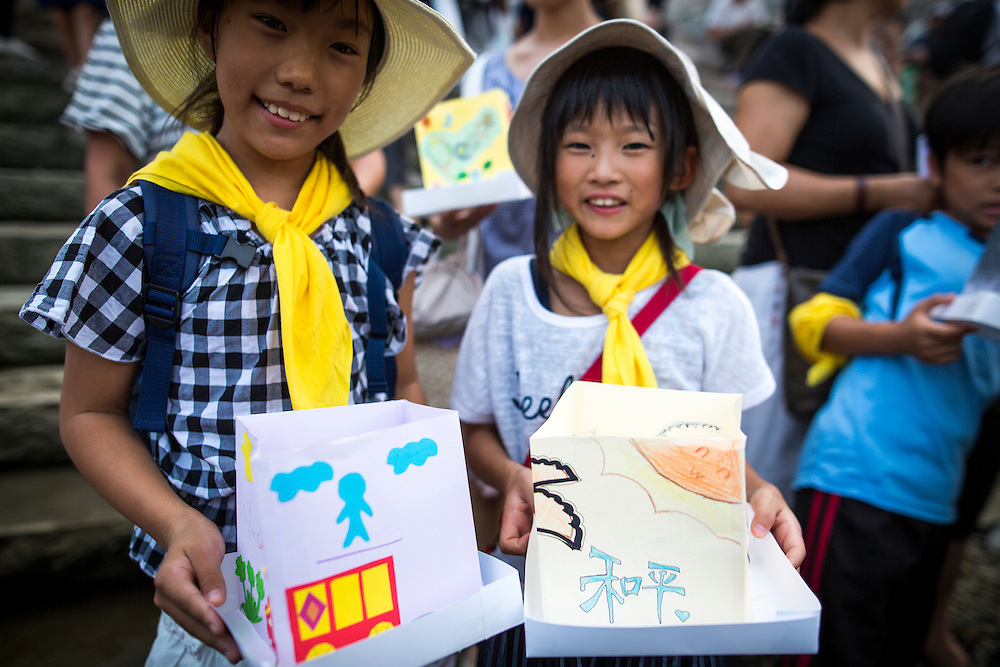 HIROSHIMA, JAPAN - AUGUST 6 : Children wait to float candle lit lanterns with their written message on the Motoyasu River during the 71st anniversary activities, commemorating the atomic bombing of Hiroshima at the Hiroshima Peace Memorial Park on August 6, 2016 in Hiroshima, western Japan. Japan marks the 71st anniversary of the first atomic bomb that was dropped by the United States on Hiroshima on August 6, 1945 during World War II.  (Photo by Richard Atrero de Guzman/NURPhoto)
