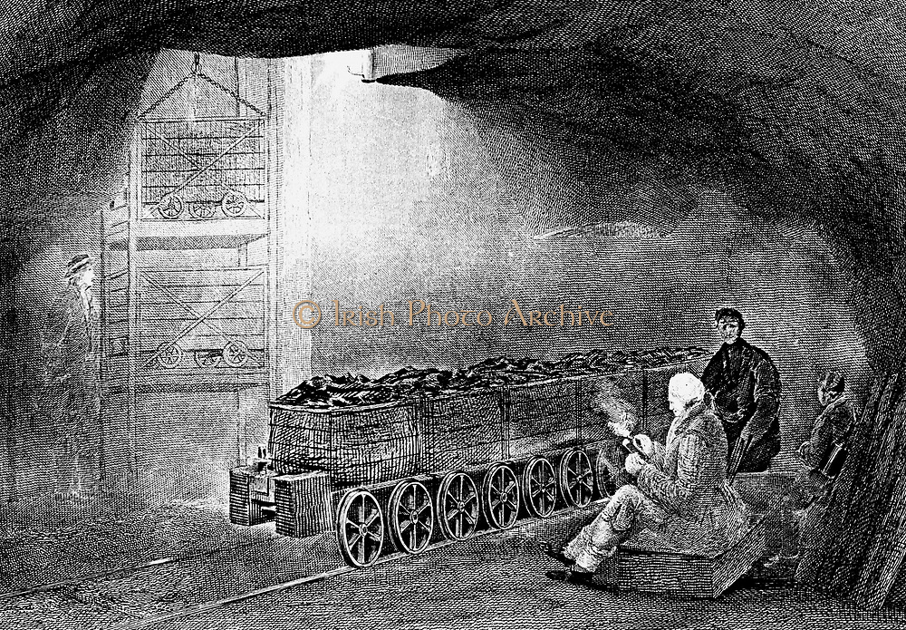 Coal Mining : Bottom of  pit shaft with train of wagons waiting to be hoisted to surface.  Flanged wheels on coal wagon.  From W Fordyce 'A History of Coal, Coke, Coal Fields ...' London, 1860. Engraving.