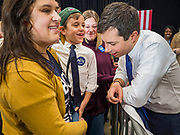 08 DECEMBER 2019 - CORALVILLE, IOWA: Mayor PETE BUTTIGIEG talks to a boy who dressed as Buttigieg at a campaign event in Coralville, Iowa. Buttigieg, the mayor of South Bend, Indiana, is running to be the Democratic nominee for President in the 2020 election. Iowa traditionally holds the first presidential selection event of the 2020 election cycle. The Iowa Caucuses are on Feb. 3, 2020.      PHOTO BY JACK KURTZ