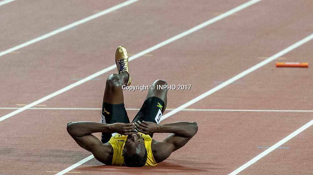 2017 World Athletics Championships Day 9, London Stadium, London, England 12/8/2017<br /> Jamaica's Usain Bolt lies injured after the last leg of the Men;s 4x100m Final<br /> Mandatory Credit &copy;INPHO/Morgan Treacy