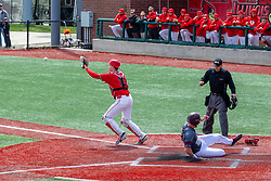 NORMAL, IL - April 08: Ben Whetstone slides across the plate under the eye of Shane Cannon but the ball is well in front of the plate being harnessed by Tyson Hays during a college baseball game between the ISU Redbirds  and the Missouri State Bears on April 08 2019 at Duffy Bass Field in Normal, IL. (Photo by Alan Look)