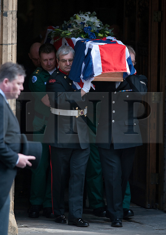 © London News Pictures. 10/03/2012.  Newcastle, UK. Members of the Emergency services carrying the coffin from Newcastle Cathedral in Newcastle upon Tyne following a formal police memorial service in the memory of PC David Rathband, who was found dead in his Northumberland Home on February 29. PC David Rathband was left blind after being shot in the face by gunman Raoul Moat.  Photo credit : Ben Cawthra/LNP