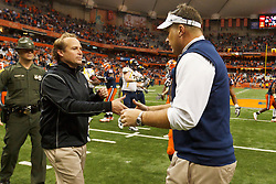 Oct 21, 2011; Syracuse NY, USA;  West Virginia Mountaineers head coach Dana Holgorsen (left) shakes hands with Syracuse Orange head coach Doug Marrone (right) after the game at the Carrier Dome.  Syracuse defeated West Virginia 49-23. Mandatory Credit: Jason O. Watson-US PRESSWIRE