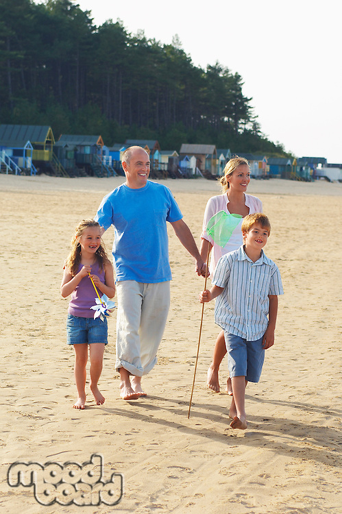 Vacationing Family walking on Beach
